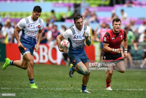 Jean Pascal Barraque of France runs in a try against Wales during the third day of the Hong Kong Rugby Sevens Tournament on April 9 2017 / AFP PHOTO...