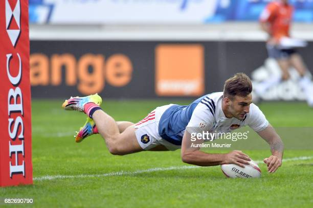 Jean Pascal Barraque of France scores a try during the HSBC rugby sevens match between France and Spain on May 13 2017 in Paris France