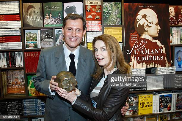 Jean Pascal Hesse and Cyrielle Clair pose with the Bronze skull of the Marquis de Sade during the launch celebration of 'Donatien Alphonse Francois...