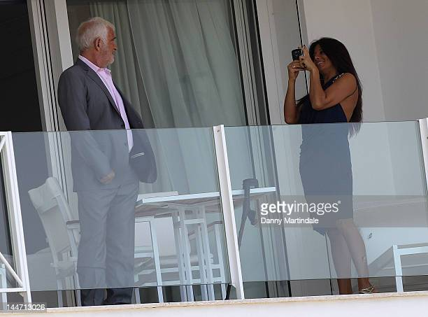 Jean Paul Belmondo and Barbara Gandolfi are seen at Edan Roc during the 65th Cannes Film Festival on May 17 2012 in Antibes France