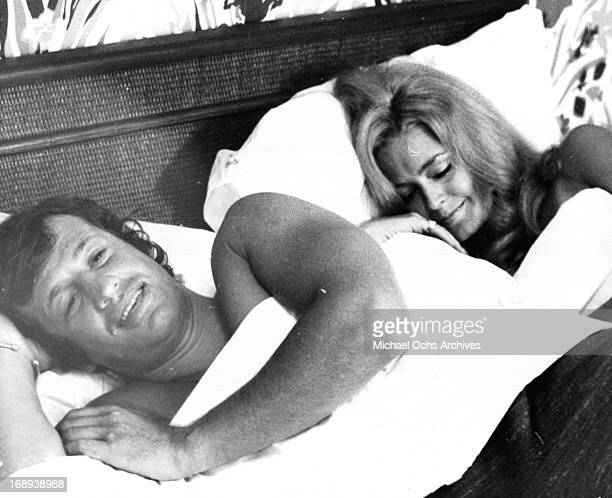 Jean Paul Belmondo lies in bed with Farrah Fawcett in a scene from the film 'Love Is A Funny Thing' 1969