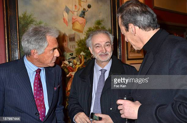 Jean Paul Enthoven Jacques Attali and a jury member attend the Procope Des Lumieres' Literary Awards First Edition at the Procope on January 30 2012...