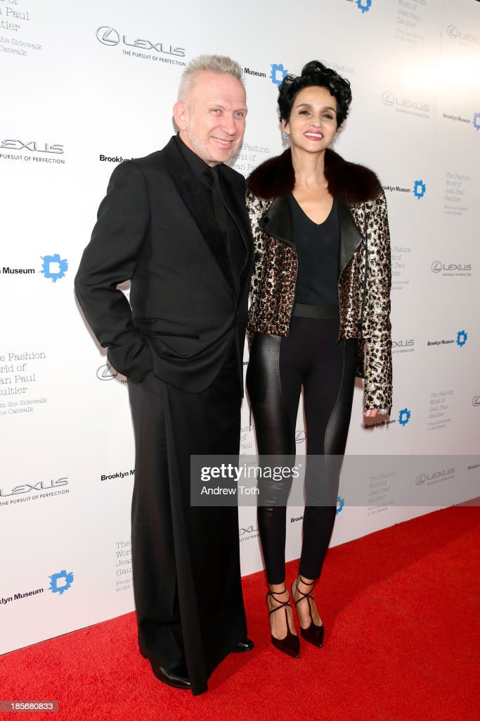 Jean Paul Gaultier and model Farida Khelfa attend the VIP reception and viewing for The Fashion World of Jean Paul Gaultier: From the Sidewalk to the Catwalk at the Brooklyn Museum on October 23, 2013 in the Brooklyn borough of New York City.