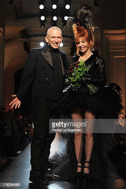Jean Paul Gaultier and Mylene Farmer walk the runway during the Jean Paul Gaultier Haute Couture Fall/Winter 2011/2012 show as part of Paris Fashion...