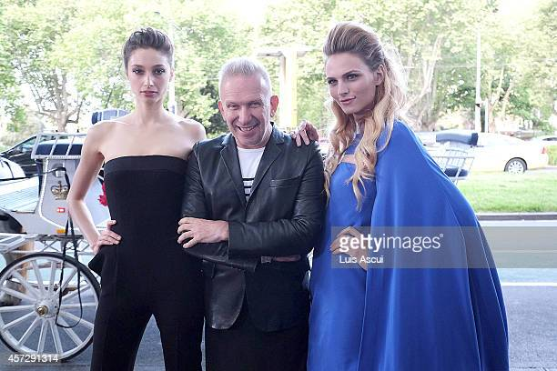 Jean Paul Gaultier arrives with models Andreja Pejic and Alexandra Agoston to the opening night of The Fashion World of Jean Paul Gaultier at the...