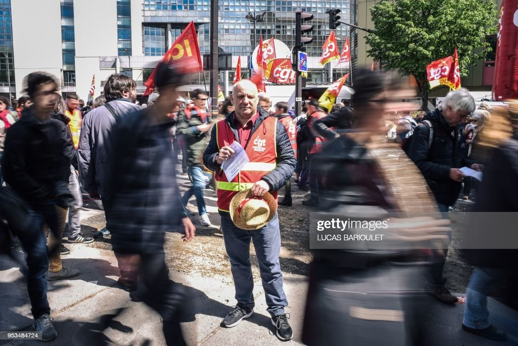 TOPSHOT - Jean Paul Horville, a 56 year old, security guard and union representative at CGT, poses during the annual May Day workers' rally in Paris on May 1, 2018.