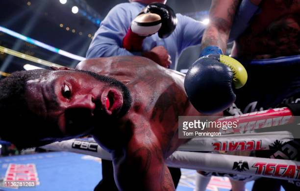 Jean Pierre Augustin falls out of the ring after being hit by Chris Arreola during a Premier Boxing Champions Heavyweight Bout at ATT Stadium on...
