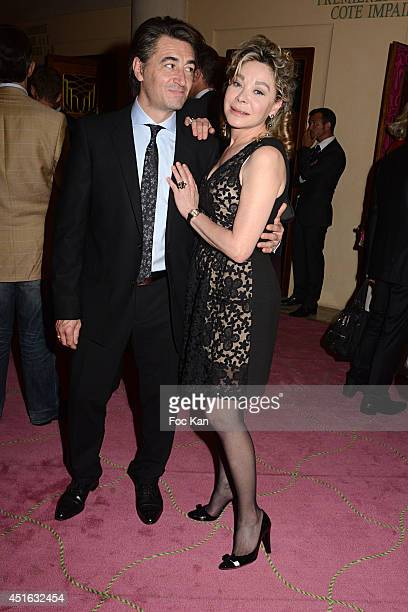 Jean Pierre Jacquin and Grace de Capitani attend the '20th Amnesty International France' Gala At Theatre Des champs Elysees on July 2 2014 in Paris...