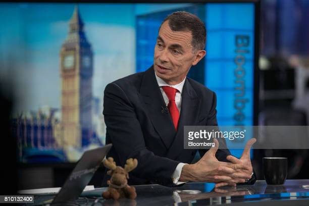 Jean Pierre Mustier chief executive officer of UniCredit SpA gestures while speaking during a Bloomberg Television interview in London UK on Friday...