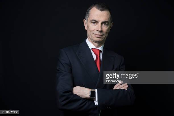Jean Pierre Mustier chief executive officer of UniCredit SpA poses for a photograph before a Bloomberg Television interview in London UK on Friday...