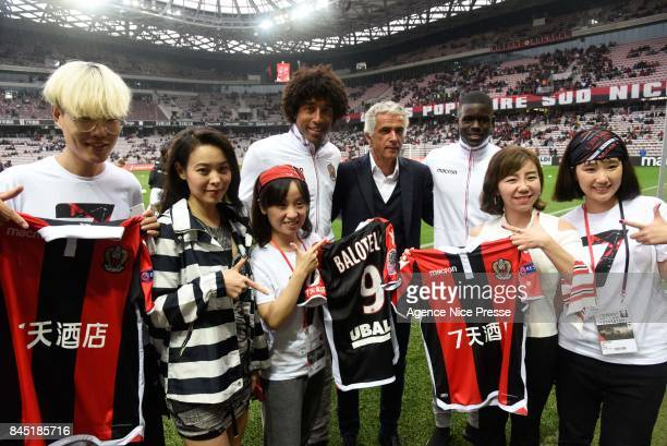 Jean Pierre Rivere president of Nice Dante and Malang Sarr with new chinese sponsor '7 Days Inn' during the Ligue 1 match between OGC Nice and AS...