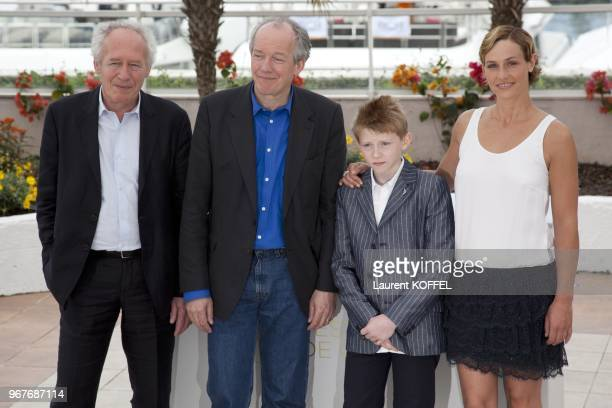 Jean Pierre Thomas Doret Cecile de France and Luc Dardenne pose at the Le Gamin Au Velo Portrait Session during the 64th Annual Cannes Film Festival...