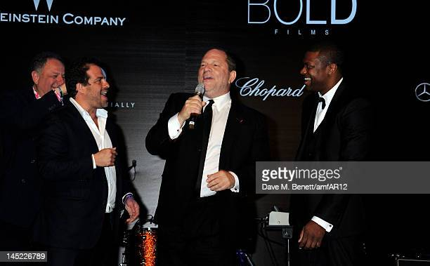 Jean Pigozzi director Brett Ratner chairman of The Weinstein Company Harvey Weinstein and actor Chris Tucker attend the 2012 amfAR's Cinema Against...