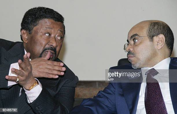 Jean Ping Chairperson of the African Union speaks to Prime Minister of Rwanda Makuza Bernard during the African Union Peace and Security Council...