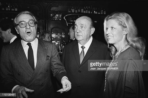 Jean Poiret Bernard Blier and wife Annette at Maxim's restaurant attributing to Elvire Popesco in Paris France on December 19 1983