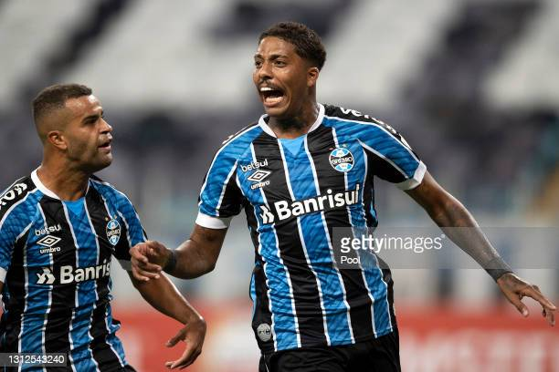 Jean Pyerre of Gremio celebrates with teammate after scoring the first goal of his team during a third round second leg match between Gremio and...