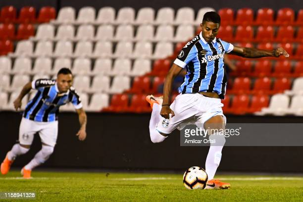 Jean Pyerre of Gremio takes a penalty kick to score the opening goal during a round of sixteen second leg match between Libertad and Gremio at...