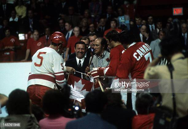 Jean Ratelle and Phil Esposito of Canada exchange a flag to the Soviet Union before Game 1 of the 1972 Summit Series on September 2 1972 at the...