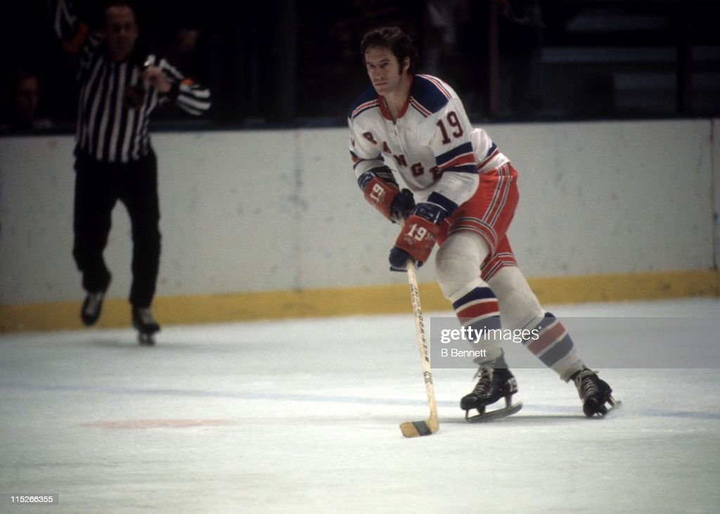 Jean Ratelle #19 of the New York Rangers skates with the puck during an NHL game circa 1974 at the Madison Square Garden in New York, New York.