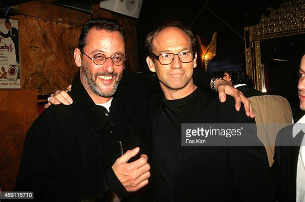 Jean Reno and a guest attend a fashion week Party at Les Bains Douches in the 1990s in Paris France