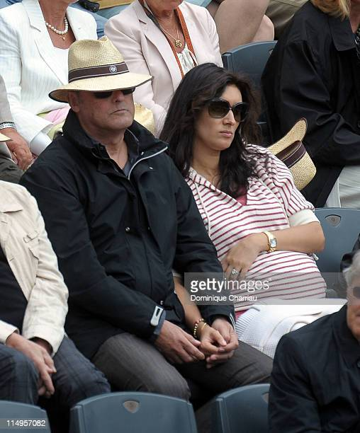 Jean Reno and his wife Zofia Borucka attend the French Open at Roland Garros on May 31 2011 in Paris France