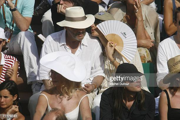Jean Reno with his wife Zofia Borucka at the Men's Single match between Roger Federer and Rafael Nadal during the 2006 French Open Tournament at the...