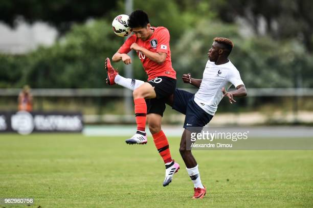 Jean Ricner Bellegarde of France and Kangin Lee of South Korea during the International Festival Espoirs match between France and South Korea on May...