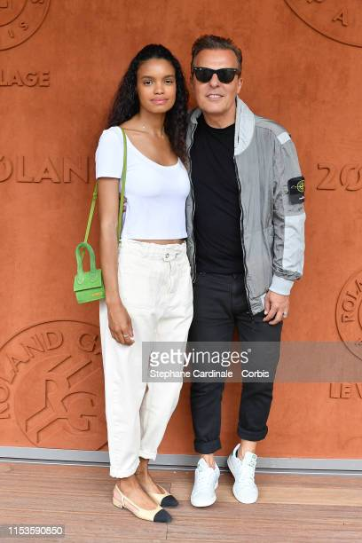 Jean Roch and his wife Anais Pedri Monory attend the 2019 French Tennis Open - Day Eight at Roland Garros on June 03, 2019 in Paris, France.