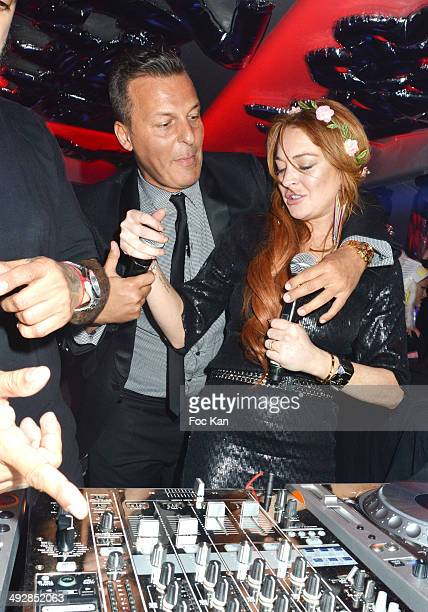 Jean Roch Pedri and Lindsay Lohan perform at the VIP Room JW Marriot on Day 8 of the 67th Annual Cannes Film Festival on May 21, 2014 in Cannes,...