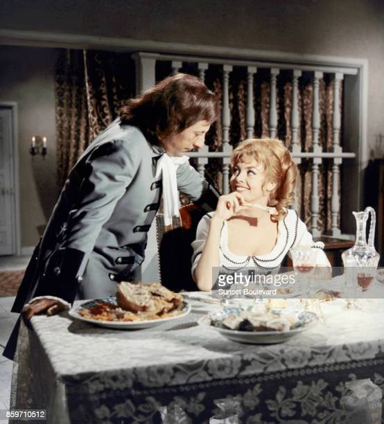 "Jean Rochefort and Michele Mercier on the set of ""Merveilleuse Angelique"" directed by Bernard Borderie"