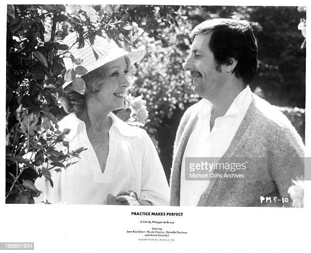 Jean Rochefort smiles at a woman in a scene from the film 'Le Cavaleur' 1979