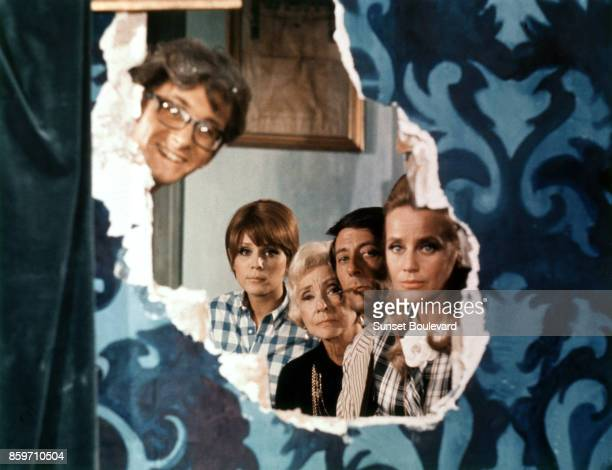 Jean Rochefort with Xavier Gelin Marthe Keller Madeleine Renaud and Maria Schell on the set of Le diable par la queue directed by Philippe de Broca