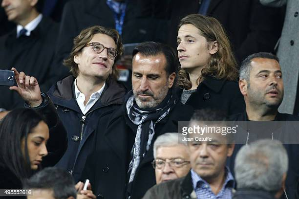 Jean Sarkozy and his brother Pierre Sarkozy attend the UEFA Champions League match between Real Madrid and Paris SaintGermain at Santiago Bernabeu...