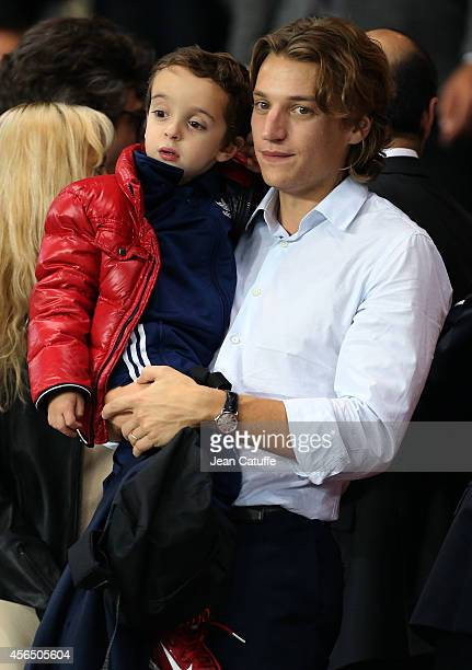 Jean Sarkozy and his son Solal Sarkozy attend the UEFA Champions League Group F match between Paris SaintGermain FC and FC Barcelona at the Parc des...