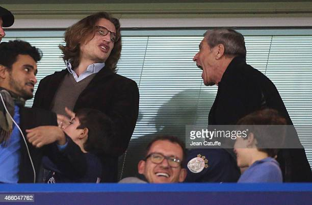 Jean Sarkozy and JeanClaude Darmon attend the UEFA Champions League Round of 16 second leg match between Chelsea FC and Paris SaintGermain FC at...