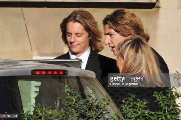 Jean Sarkozy arrives with his brother Pierre Sarkozy and his Mother Marie Culioli to attend his wedding with Jessica SebaounDarty on September 10...