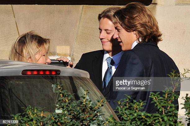 Jean Sarkozy arrives with his brother Pierre Sarkozy and his Mother Marie Culioli to attend the his wedding with Jessica SebaounDarty on September 10...