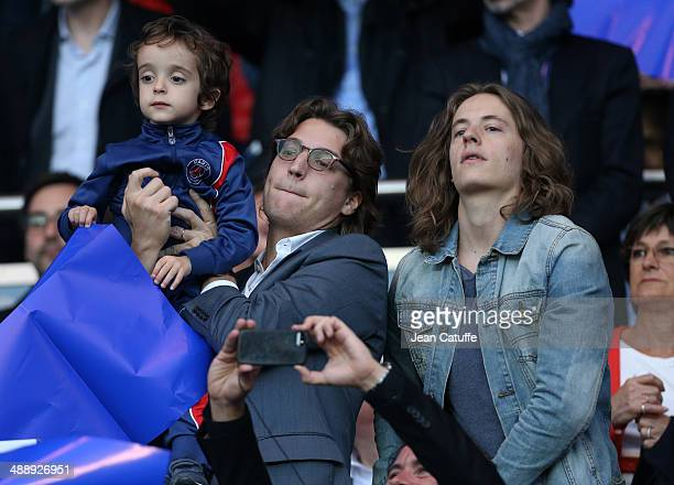 Jean Sarkozy holding his son Solal Sarkozy and his brother Pierre Sarkozy attend the french Ligue 1 match between Paris SaintGermain FC and Stade...