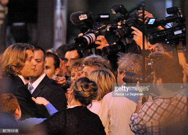 Jean Sarkozy is greeted by media and supporters after his wedding to Jessica SebaounDarty on September 10 2008 in Neuilly sur Seine France