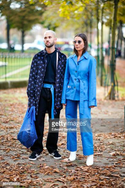 Jean Sebastien Rocques and Alice Barbier from the blog 'J'aime Tout Chez Toi' wear blue outfits outside the Rochas show during Paris Fashion Week...