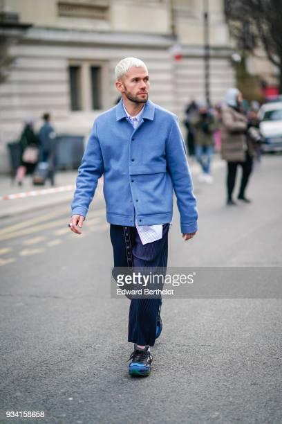 Jean Sebastien Rocques wears a blue jacket a blue eyelet belt navy blue pants blue sneakers during Paris Fashion Week Womenswear Fall/Winter...