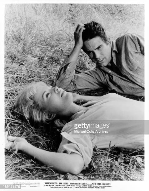 Jean Seberg and Warren Beatty laying in the grass together in a scene from the film 'Lilith', 1964.