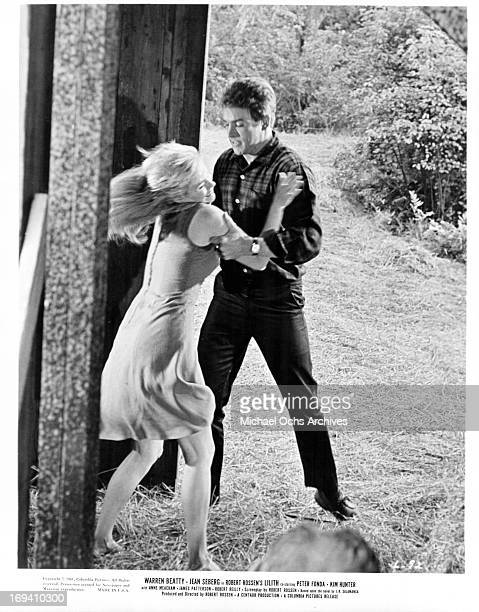 Jean Seberg struggles with Warren Beatty in a scene from the film 'Lilith', 1964.