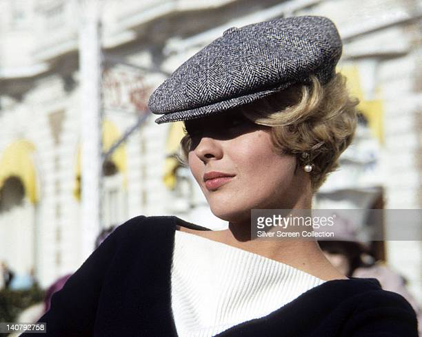 Jean Seberg , US actress, wearing a tweed flat cap and a black and white top, circa 1965.