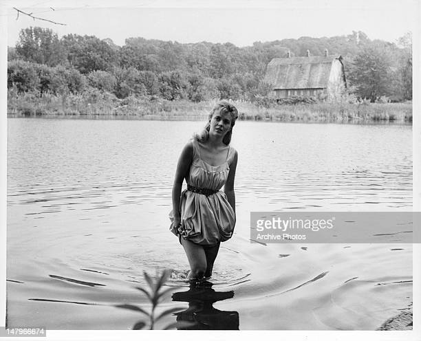 Jean Seberg walking in knee high water in a scene from the film 'Lilith', 1964.