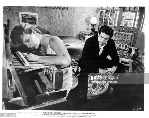 Jean Seberg weaves while Warren Beatty sits on the bed in a scene from the film 'Lilith', 1964.