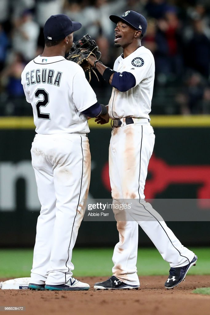 Jean Segura #2 and Dee Gordon #9 of the Seattle Mariners celebrate their 3-1 win against the Tampa Bay Rays during their game at Safeco Field on June 2, 2018 in Seattle, Washington.