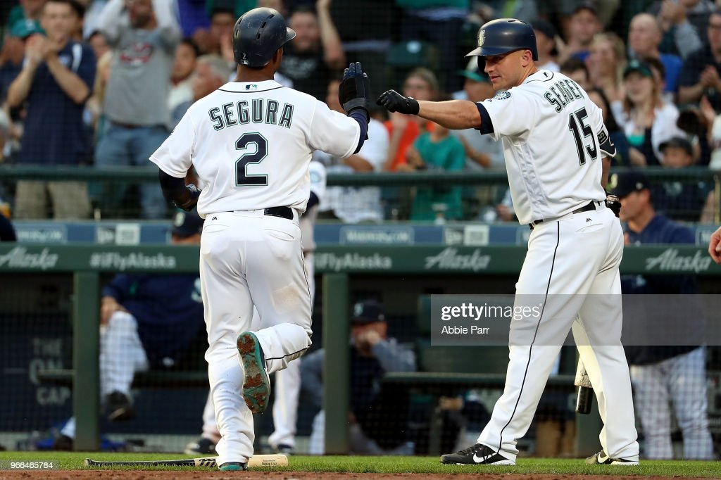 Jean Segura #2 high fives Kyle Seager #15 after scoring off a single by Nelson Cruz #23 of the Seattle Mariners in the third inning against the Tampa Bay Rays during their game at Safeco Field on June 2, 2018 in Seattle, Washington.