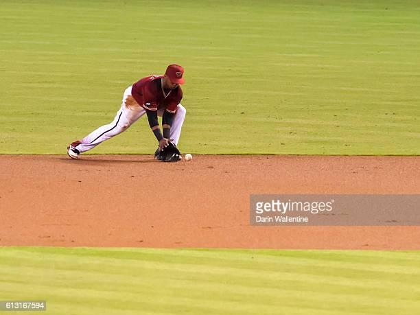 Jean Segura of the Arizona Diamondbacks fields a grounder in the second inning of the MLB game between the San Diego Padres and Arizona Diamondbacks...