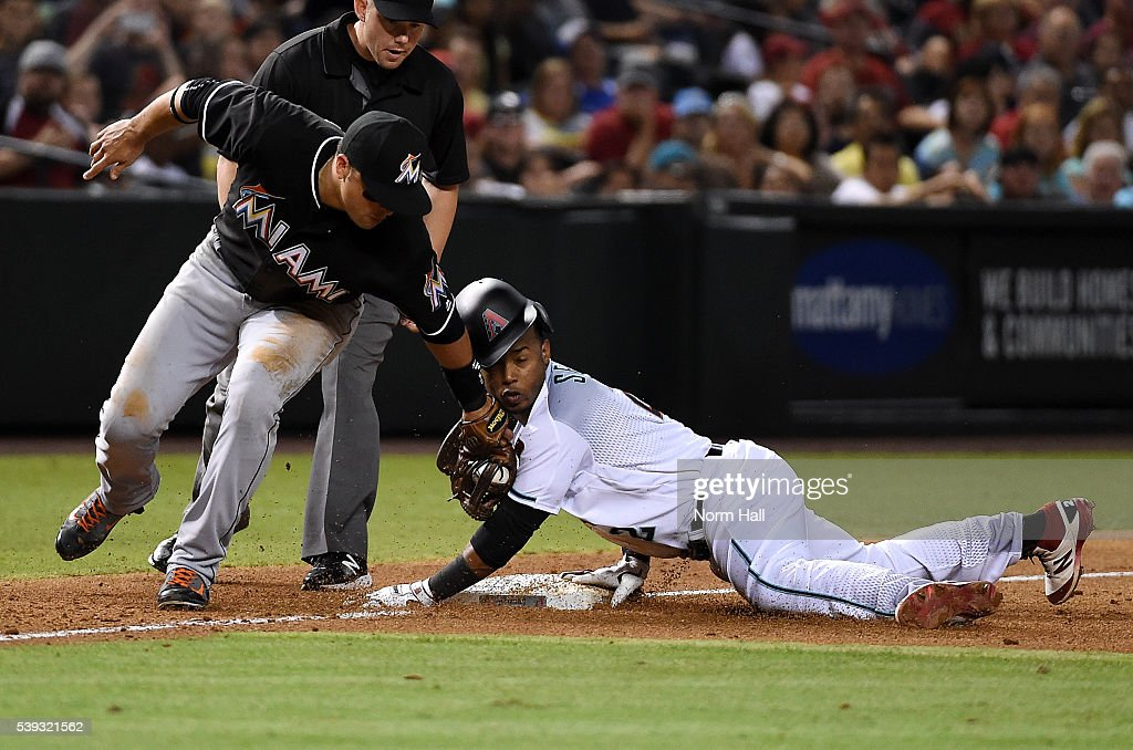 Jean Segura #2 of the Arizona Diamondbacks safely steals third base just ahead of the tag by Martin Prado #14 of the Miami Marlins during the sixth inning at Chase Field on June 10, 2016 in Phoenix, Arizona.